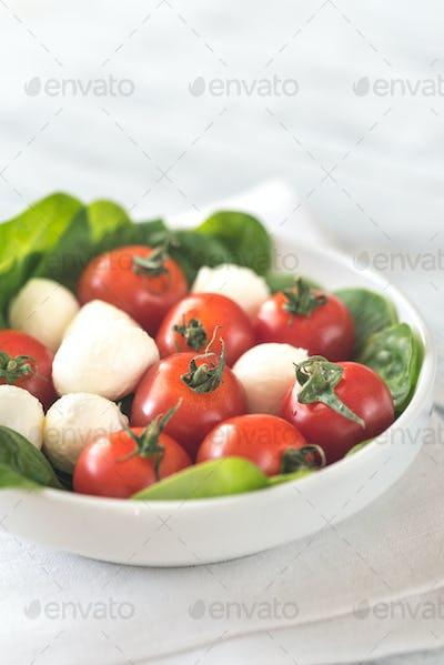 Fresh cherry tomatoes with mozzarella