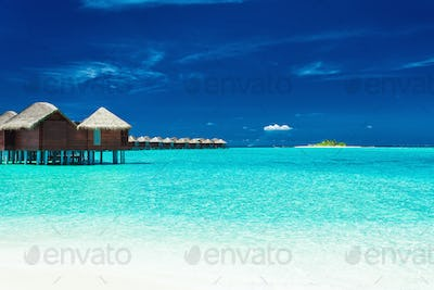 Over water bungalows with steps into lagoon, Maldives