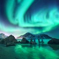Green aurora borealis and people. Northern lights