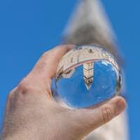 Saint Nikola Church tower reflected in a glass ball