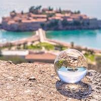Sveti Stefan reflected in a glass ball