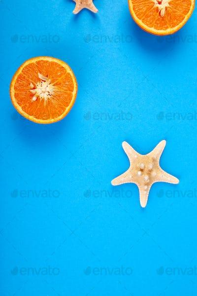 Summer concept. Orange fruit and starfish