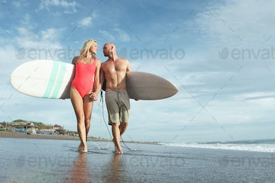 Smiling couple on the beach