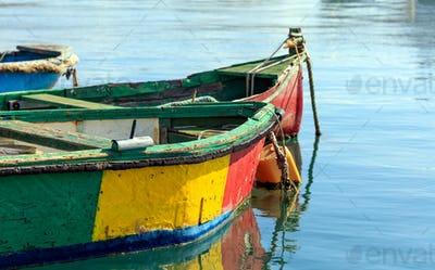 Traditional colorful boats luzzu at the port of Marsaxlokk, Malta. Copy space, closeup view