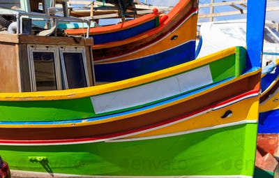 Traditional colorful boat luzzu at the port of Marsaxlokk, Malta. Copy space, closeup view