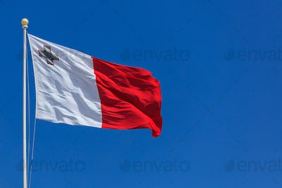 Malta flag. Malta flag on a pole waving on blue sky background