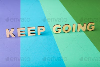 Keep going inscription on colorful background