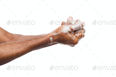 Black man washing hands isolated on white background