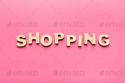 Word Shopping on pink background with copy space