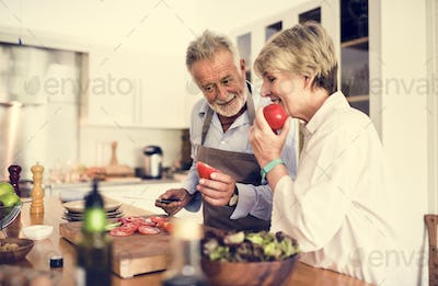 Couple are cooking in the kitchen together