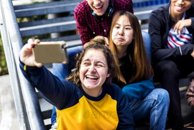 Group of school friends having fun and taking a selfie