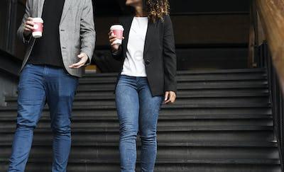 Business partners having take away coffee
