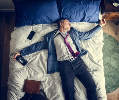 Drunk business man falling asleep as soon as he came back home