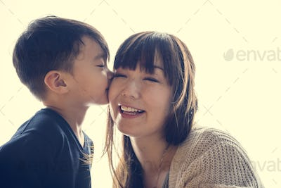 Japanese boy kissing his mother