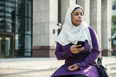 Islamic woman looking and waiting for someone