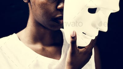 African woman holding white mask