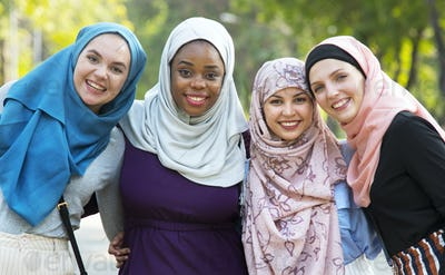 Group of islamic friends embracing and smiling together