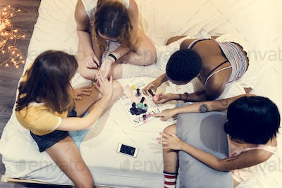 Group of diverse women painting their nails