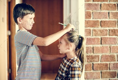 Siblings checking height
