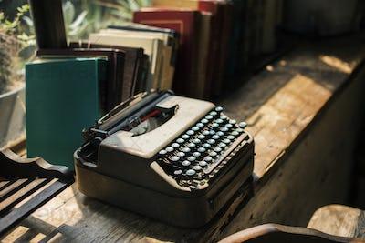Closeup of retro typewriter on wooden table