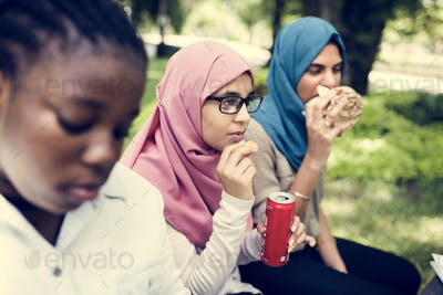 A group of diverse students are having lunch together