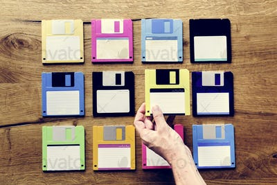 Hand holding floppy disk drive data storage