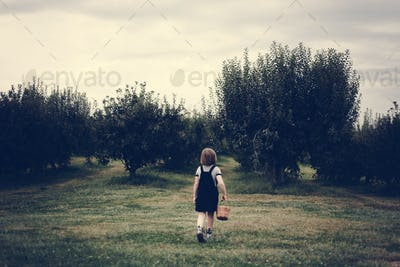 Little girl playing in a farm