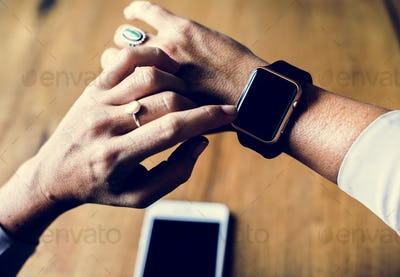 Hands setting a electronic smart watch
