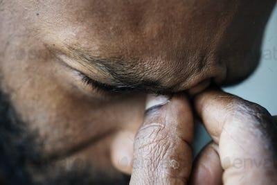 Portrait of stressed black man