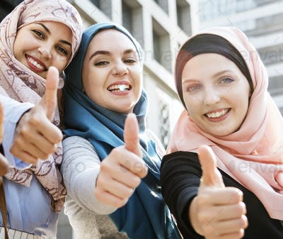 Group of islamic women gesturing thumps up