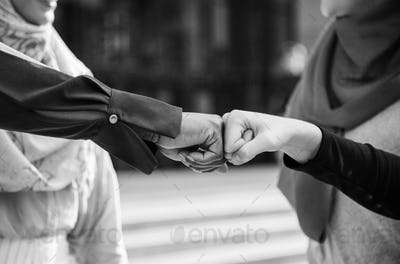 Islamic women friends fist bumps