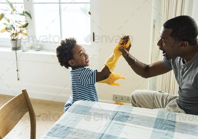 Dad and son playing together