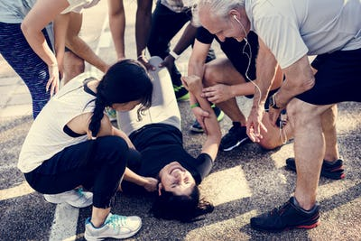 Group of people assisting an injured person