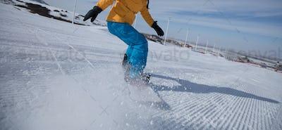 Snowboarding on mountain slope