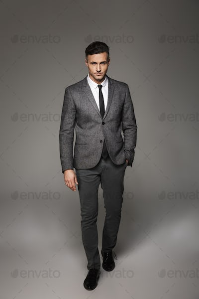 Full length portrait of successful businessman wearing business