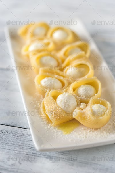Lumaconi pasta stuffed with bocconcini