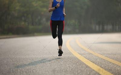 Runner running on street in the morning