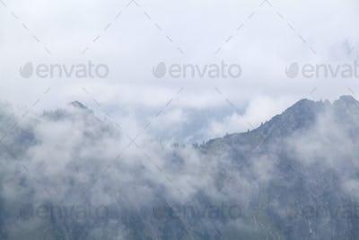 mountains in dense fog