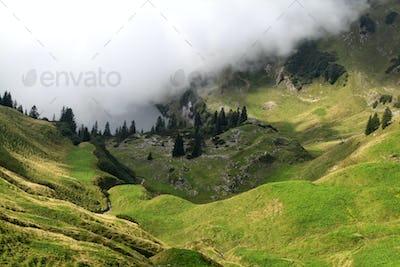 fog over alpine lake in valley