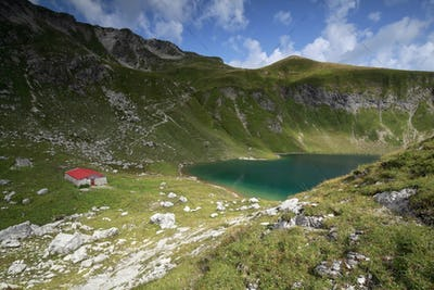 old cabin by alpine turquoise lake