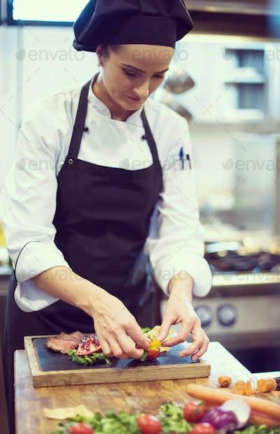 female Chef preparing beef steak