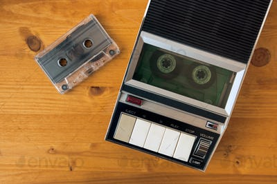 Audio cassette tape rolling in vintage player