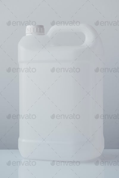 White plastic jerrycan canister for chemical liquids