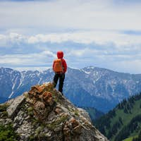 Hiker stand on the top of mountain