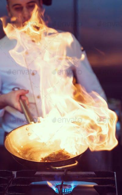 Chef doing flambe on food