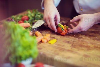 closeup of Chef hands preparing beef steak
