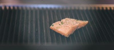 Salmon fillets cooking on grill