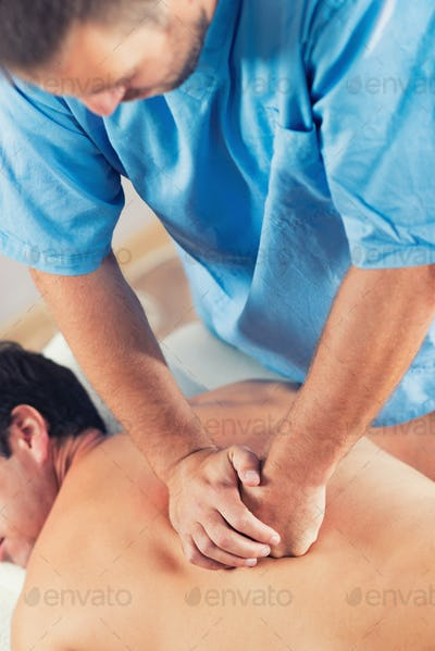 Physiotherapist Working With Patient Back