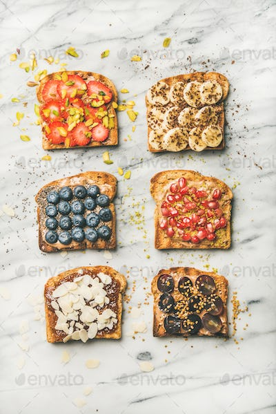 Vegan toasts with fruit, seeds, nuts and peanut butter