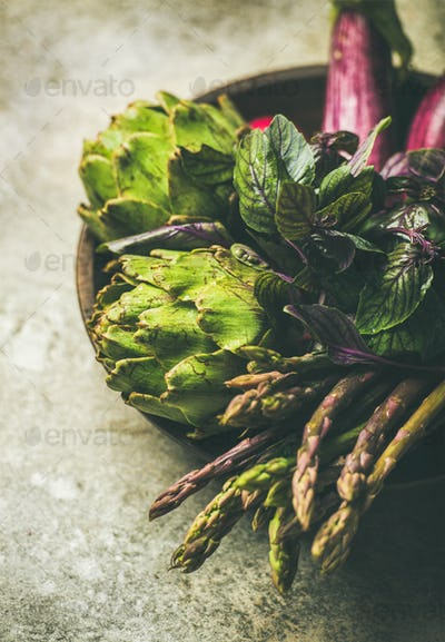 Flat-lay of green and purple vegetables on plate, selective focus